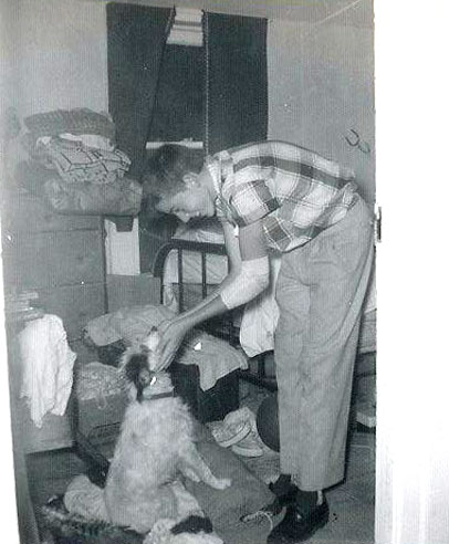 picture of Joe burgess with his dog Zip as they packed to move to Silver City, NM