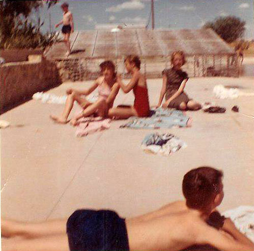 picture of Phyllis,DonnaLyn, Nina & Buddy at the Ft Stockton swimming pool, late '50s