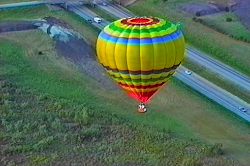 balloon flying over highway near Ft. Worth, Texas