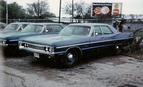 Texas Department of Public Safety cars in lot for auction in 1970.  We bought the 2 shown in the photo.  Martin kept one and his Mom kept one.