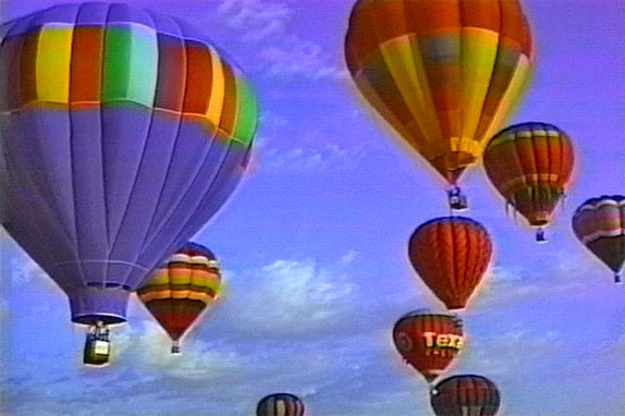hot ai balloons flying over harris branch in Austin, Texas