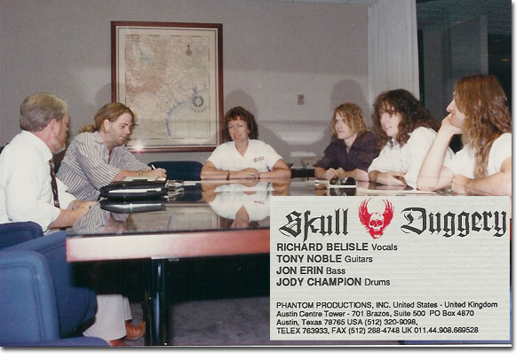 picture of the signing of management contract between Phantom Productions and the metal band Skull Duggery