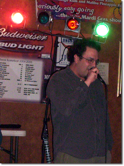 picture of Ken at Kareoke during Sheila and Michael's visit