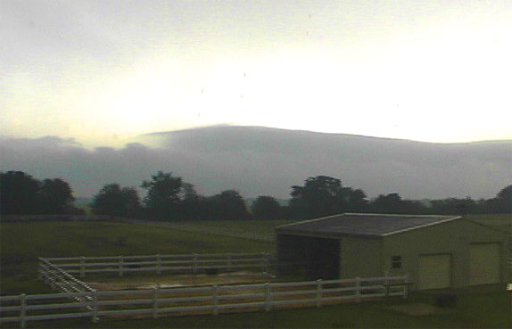 picture of cloud bank behind stable