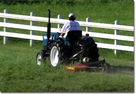 Chris mowing on new tractor